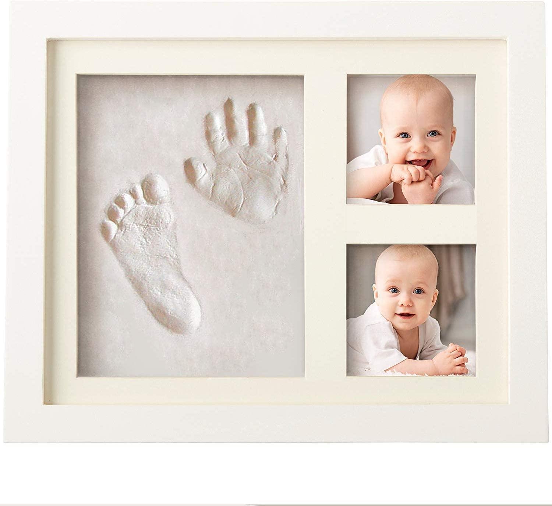 Marco blanco con huellas y fotos de bebé